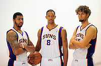 Dec. 16, 2011; Phoenix, AZ, USA; Phoenix Suns forward Markieff Morris (left), center Channing Frye (center) and center Robin Lopez pose for a portrait during media day at the US Airways Center. Mandatory Credit: Mark J. Rebilas-
