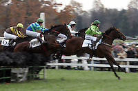 Rider jump over national fences during the 4th race during the Montpelier Hunt Races Saturday in Orange, Va. Andrew Shurtleff