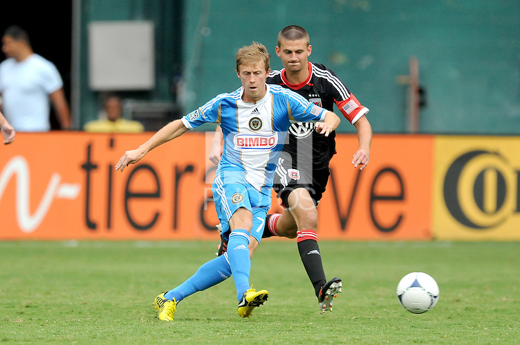 Philadelphia Union midfielder Brian Carroll (7) holds the ball follow by D.C. United midfielder Perry Kitchen (23) D.C. United tied The Philadelphia Union 1-1 at RFK Stadium, Saturday August 19, 2012.