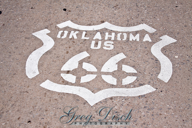 Oklahoma US 66 shield painted on the road in El Reno Oklahoma.