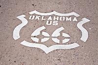 Oklahoma US 66 shield painted on the road in El Reno Oklahoma.