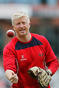 7th September 2017, Emirates Old Trafford, Manchester, England; Specsavers County Championship, Division One; Lancashire versus Essex; Lancashire coach Glen Chapple warms up his fielders before the start of the Essex innings this morning