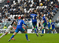 1st December 2019; Allianz Stadium, Turin, Italy; Serie A Football, Juventus versus Sassuolo; Cristiano Ronaldo of Juventus wins a header in the 90th minute - Editorial Use