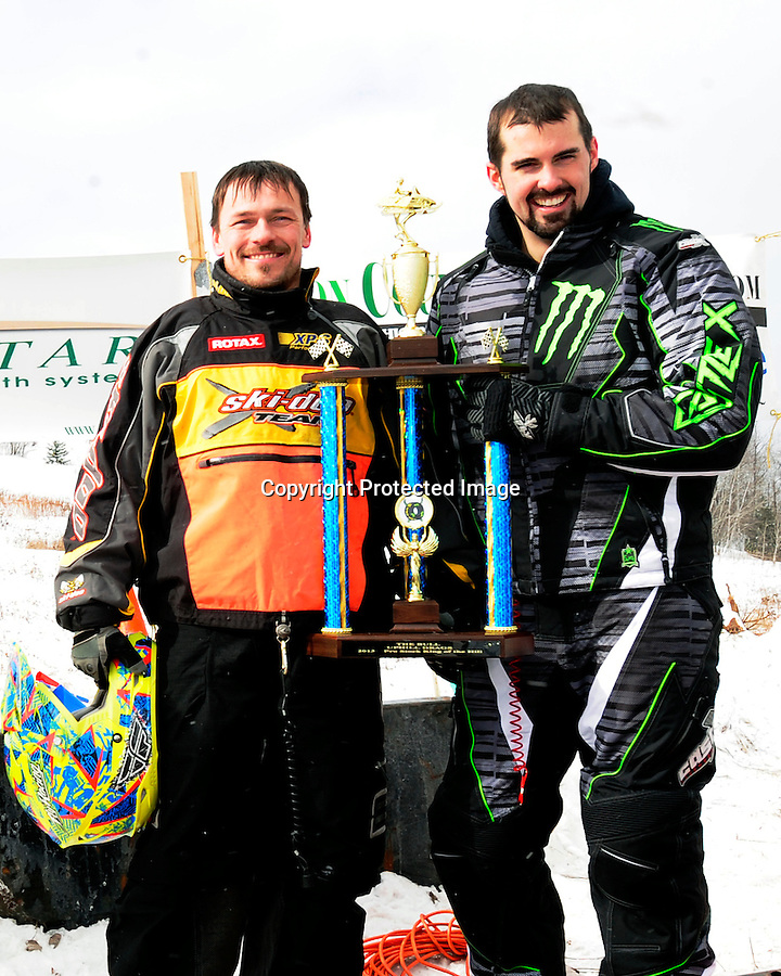 """King of the Hill"" winners Wyler ""Wild Man"" Miller and Jordan Stank of the Caspian Ski Hill competition during the 2013 MASTERS Hillclimb in Caspian, MI on Saturday, Feb. 16."