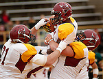 OCTOBER 4, 2014 -- D.J. Hubbard #21 of Colorado Mesa celebrates with teammates after a touchdown against Black Hills State during their Rocky Mountain Athletic Conference game Saturday at Lyle Hare Stadium in Spearfish, S.D.  (Photo by Dick Carlson/Inertia)