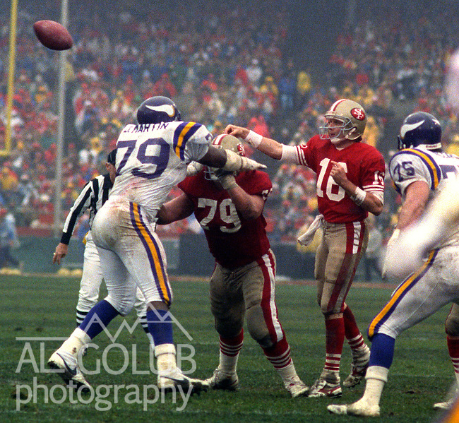 San Francisco 49ers vs  Minnesota Vikings  at Candlestick Park Saturday, January 9, 1988.. Vikings beat 49ers 36-24.San Francisco 49ers Guard Harris Barton (79) holds off Minnesota Vikings Defensive End Doug Martin (79) while Quarterback Joe Montana (16) passes..