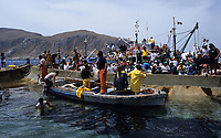ITALY, Sicily, Egedian island Favignana, La Mattanza, traditional fishing of bluefin Tuna fish, rais (chief) Gioacchino Cataldo and tourists watching the spectacle