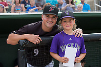 Kannapolis Intimidators manager Justin Jirschele (9) poses for a photo with Betty Altschuler, who was the guest manager for the night, prior to the game against the Hickory Crawdads at Kannapolis Intimidators Stadium on April 22, 2017 in Kannapolis, North Carolina.  The Intimidators defeated the Crawdads 10-9 in 12 innings.  (Brian Westerholt/Four Seam Images)