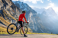 A cyclist stopped to drink on the Grosse Scheidegg pass, Switzerland