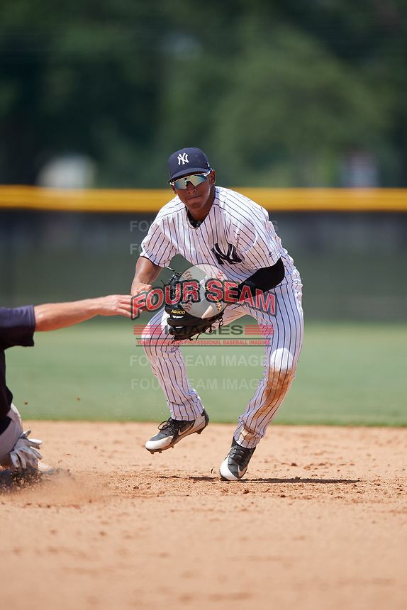 GCL Yankees West shortstop Roberto Chirinos (32) prepares to throw to first base during a game against the GCL Yankees East on August 8, 2018 at Yankee Complex in Tampa, Florida.  GCL Yankees West defeated GCL Yankees East 8-4.  (Mike Janes/Four Seam Images)