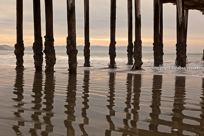 the Cayucos pier, reflecting off the sand.  Cayucos california.