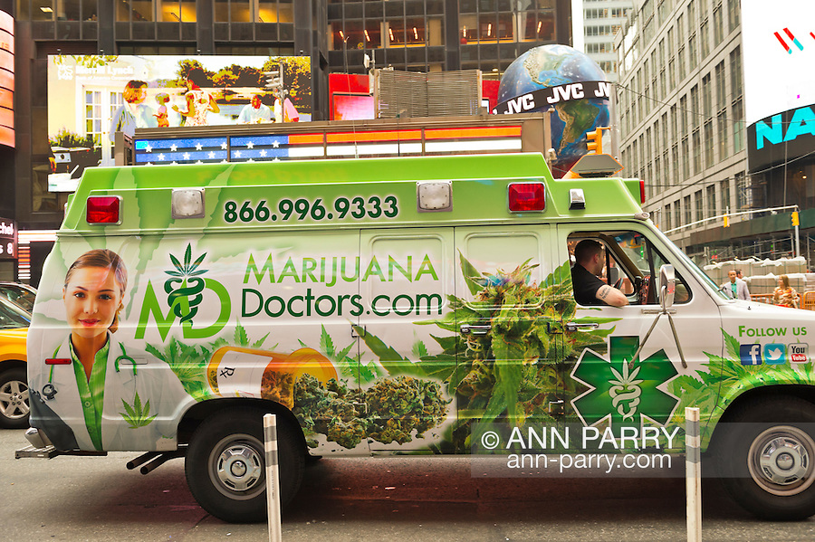 Manhattan, New York, U.S. - May 21, 2014 - In Times Square, a green and white van for MarijuanaDoctors.com, a service that connects patients with doctors who prescribe marijuana for medical use, drives on 7th Avenue during a pleasant Spring day in Manhattan. Van has phone number and illustrations of marijuana plants and more.