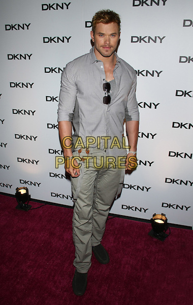 Kellan Lutz.The DKNY Sunglass Soiree at The Beach in the Dream Downtown Hotel, New York, NY, USA..July 26th, 2011.full length grey gray shirt beige khaki trousers .CAP/LNC/TOM.©TOM/LNC/Capital Pictures.