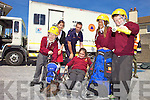 IMPORTANT INFORMATION: Commander of the Civil Defence Paul McDonnell shows Ruairi Switzer, Shannon McInerney, Diana Racvoa and Michael Flynn from 4th class Holy Family primary school and their teacher Niamh Shanahan how to use equipment when out on a rescue at CD Headquarters in Tralee on Tuesday.