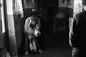 Hrubieszow,  South East Poland November 2005<br /> The faces of Polish poverty<br /> A shelter for the poor and homeless in Hrubieszow, <br /> ( &Scaron; Filip Cwik / Napo Images for Newsweek Polska)<br /> <br /> Hrubieszow k.Zamoscia 26 listopad 2005 Polska<br /> Oblicza biedy w Polsce<br /> Stowarzyszenie Przeciwdzialania Patologiom Spolecznym KRES prowadzi Ryszard Karpinski ktory wraz z czworka dzieci i zona mieszka w osrodku. Przebywa w nim 30 osob doroslych i 13 dzieci. Osrodek pobiera oplate w wysokosci 35 % przychodow mieszkanca /z emerytury , renty , zapomogi itp. /. Oferuje w zamian trzy cieple posilki dziennie, pokoj i ciepla wode.<br /> Wiekszosc Polakow niemal / 85% / z trudem radzi sobie z przezyciem od pierwszego do pierwszego. Ponad polowa / 52,5% / zalega ponad trzy miesiace z czynszem. Tyle samo osob, aby poprawic swoja sytuacje materialna radykalnie ogranicza wydatki. W beznadziejnej sytuacji jest ludnosc wiejska gdzie 18,5% zyje w skrajnej nedzy. W 1991 roku rzad polski zlikwidowal Panstwowe Gospodarstwa Rolne ktore od II Wojny Swiatowej byly miejscem pracy dla ponad 2 mln rolnikow glownie na ziemiach odzyskanych. Ci ludzie i ich rodziny nie odnalezli sie w nowej rzeczywistosci<br /> ( &Scaron; Filip Cwik / Napo Images dla Newsweek Polska)