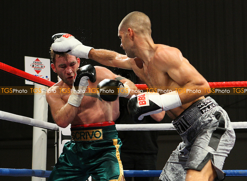 Tony Hill (silver shorts) defeats Matt Scriven in a Middleweight boxing contest at the Harvey Hadden Leisure Centre, Nottingham, promoted by Frank Maloney - 20/11/09 - MANDATORY CREDIT: Gavin Ellis/TGSPHOTO - Self billing applies where appropriate - Tel: 0845 094 6026