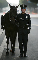 LOS ANGELES,CA - SEPTEMBER 18,2008: Honor Guard, including LAPD Officer Kevin Scott, center, walks with the riderless horse towards Cathedral of Our Lady of the Angels during a processional before funeral services for Los Angeles Police Officer Spree Desha, September 18, 2008. Desha was one of the 25 people who were killed in Friday's Metrolink train collision in Chatsworth.