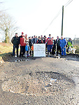 Residents of Starinagh, Broomfield, Collon pictured at one of the many potholes on their roads. Photo:Colin Bell/pressphotos.ie