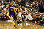 04/08/11--Portland Trailblazers' Patrick Mills is closely guarded by L.A. Lakers' Steve Blake before making a last second shot at the end of the first quarter at the Rose Garden..Photo by Jaime Valdez........................................