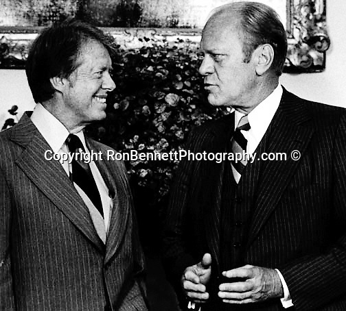 President Jimmy Carter and President Gerald Ford meet in the Oval office of the White House,