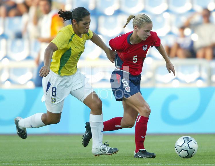 14 August 2004:  USA Lindsay Tarpley dribbles the ball away from Brazil Defender Daniela  at Kaftanzoglio Stadium in Thessaloniki, Greece.   USA defeated Brazil, 2-0. Credit: Michael Pimentel / ISI