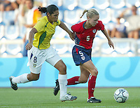 14 August 2004:  USA Lindsay Tarpley dribbles the ball away from Brazil Defender Daniela  at Kaftanzoglio Stadium in Thessaloniki, Greece.   USA defeated Brazil, 2-0. Credit: Michael Pimentel / ISI