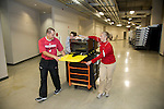 Wisconsin Badgers staff move athletic training equipment to their new room on move-in day at the LaBahn Arena Monday, October 1, 2012 in Madison, Wisc. (Photo by David Stluka)