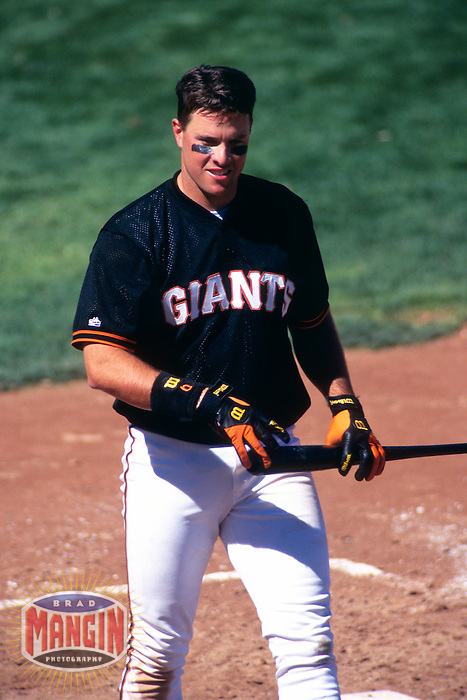 SCOTTSDALE, AZ - J.T. Snow of the San Francisco Giants bats during a spring training game against the Seattle Mariners at Scottsdale Stadium in Scottsdale, AZ in 1997. Photo by Brad Mangin