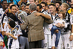 01 December 2012: Philip F. Anschutz (in suit) presents the Philip F. Anschutz Trophy to Galaxy captain Landon Donovan (10). The Los Angeles Galaxy played the Houston Dynamo at the Home Depot Center in Carson, California in MLS Cup 2012. Los Angeles won the game 3-1.