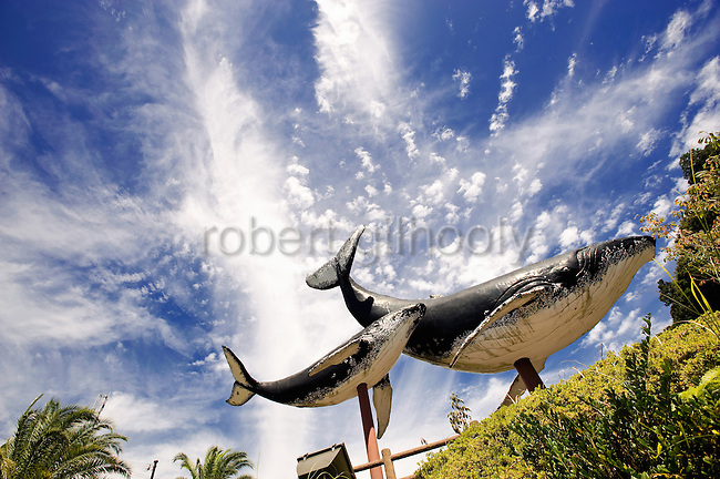 Giant whale models mark the entrance to the central part of Taiji, Japan on 10 September 2009. Japan's traditional whaling methods are said to have originated in Taiji in the 17th century, and while the whaling industry faded out here after the International Whaling Commission's moratorium on commercial whaling was implemented in 1986, dolphin hunting continues to be a prominent industry in the town. .Photographer: Robert Gilhooly