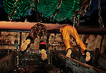 Michel and Carl, working at sea aboard the trawler 'Risten', whose home port is Le Guilvinec, France. <br />