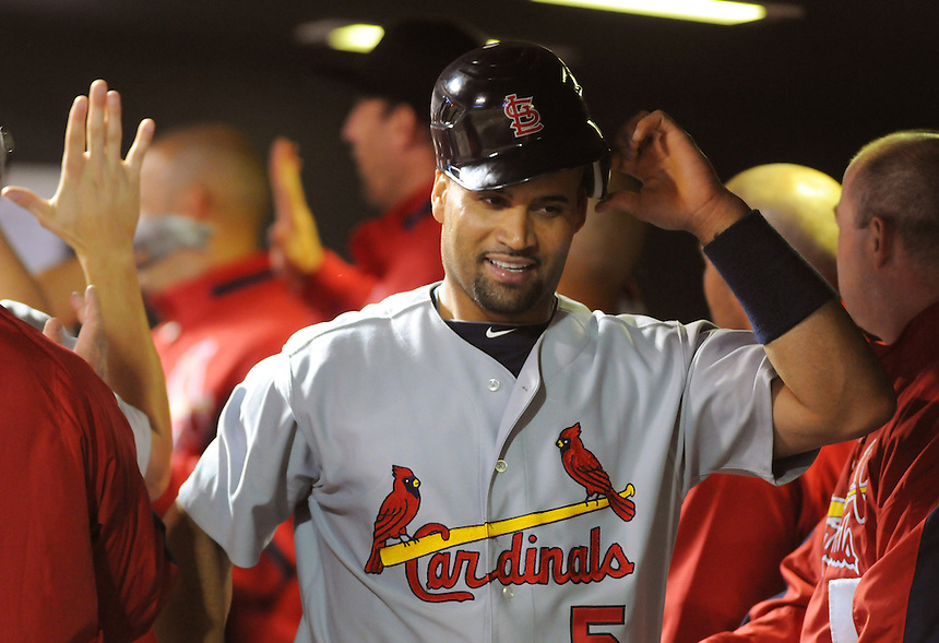06 JULY 2010: St. Louis Cardinals first baseman Albert Pujols (5) celebrates a run in the dugout during a regular season Major League Baseball game between the Colorado Rockies and the St. Louis Cardinals at Coors Field in Denver, Colorado. The Rockies beat the Cardinals 12-9 after a 9 run 9th inning.  *****For Editorial Use Only*****