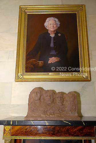 Washington, DC - November 29, 2007 -- Mount Rushmore National Memorial under the portrait of former first lady Barbara Bush in the Ground Floor Corridor, part of the 2007 White House Christmas Decorations in Washington, D.C. on Thursday, November 29, 2007..Credit: Ron Sachs / CNP