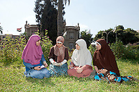 Menna, Heba Tallah, Asmaa and Heba Ahmed of the Noor Family, sit in the campus of Ain Shams University in Cairo, where they are studying law. Cairo, Egypt. October 9th, 2012.<br /> (assignment for the Financial Times)