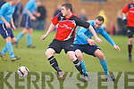 Park's David McGee gets away from Kilbarrack United's Aaron Humphries in the FAI Junior cup in Dublin on Sunday...