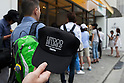 A customer show a cap with a message ''I stood in line at Dominique Ansel Bakery'' in Omotesando Hills on June 20, 2015, Tokyo, Japan. Japan is the first country outside the USA for the popular New York bakery to open a store. According to organizers, about 400 customers waited 3 to 4 hours in the morning to taste its original desserts such as the ''Cronut'' a croissant doughnut fusion creation by Chef Dominique Ansel. (Photo by Rodrigo Reyes Marin/AFLO)