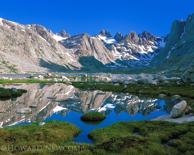 Rugged peaks of the Wind River Range reflect in Titcomb Lake, Wyoming.