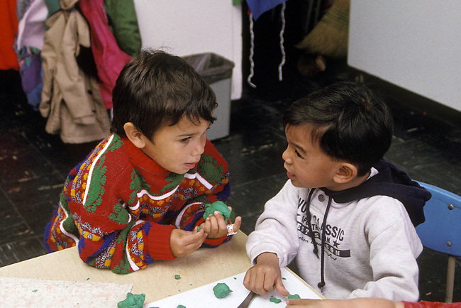 Berkeley CA Boys, three-years-old having serious talk at preschool