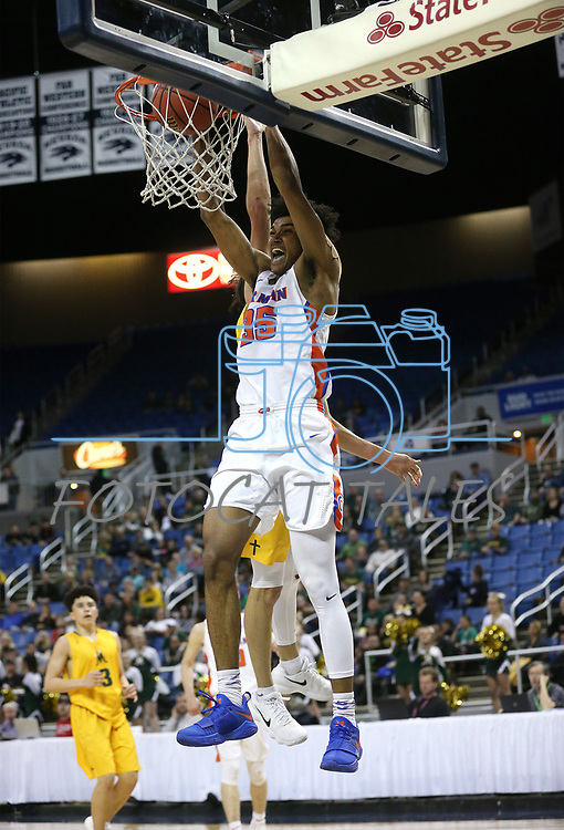 Bishop Gorman's Jamal Bey dunks against a Bishop Manogue defender during the 4A NIAA state basketball championship game in Reno, Nev., on Friday, Feb. 23, 2018. Gorman won 62-41. Cathleen Allison/Las Vegas Review-Journal