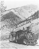 3/4 engineer's-side view of C-19 #340 with caboose at Ouray taking on water.<br /> D&amp;RGW  Ouray, CO