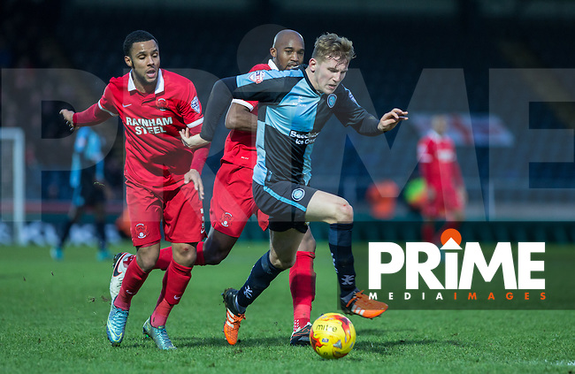 Jason McCarthy of Wycombe Wanderers heads through the Orient defence during the Sky Bet League 2 match between Wycombe Wanderers and Leyton Orient at Adams Park, High Wycombe, England on 23 January 2016. Photo by Andy Rowland / PRiME Media Images.