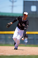 Erie Seawolves first baseman James Robbins (21) flips the ball to first after fielding a ground ball during a game against the Richmond Flying Squirrels on May 20, 2015 at Jerry Uht Park in Erie, Pennsylvania.  Erie defeated Richmond 5-2.  (Mike Janes/Four Seam Images)
