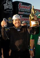 Sept. 19, 2010; Concord, NC, USA; NHRA funny car driver Cruz Pedregon celebrates after winning the O'Reilly Auto Parts NHRA Nationals at zMax Dragway. Mandatory Credit: Mark J. Rebilas-