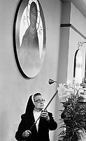 Sister Isadore Gilewitch snuffs out a candle after the 6:15 am morning service at Sisters of Saint Basil The Great motherhouse Tuesday May 1, 1990 in Jenkintown, Pennsylvania. The nuns will return at 5 pm for afternoon prayers. (Photo by William Thomas Cain/Cain Images)