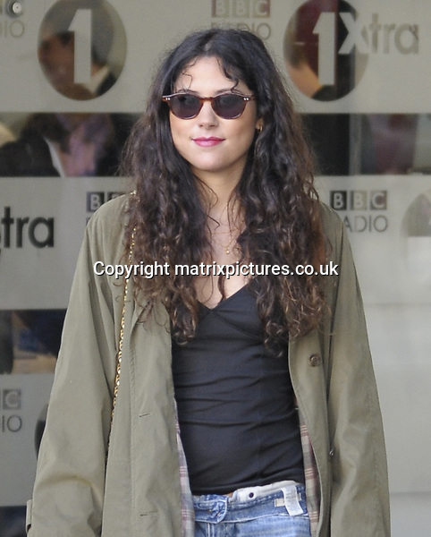 NON EXCLUSIVE PICTURE: MATRIXPICTURES.CO.UK<br /> PLEASE CREDIT ALL USES<br /> <br /> WORLD RIGHTS<br /> <br /> British singer-songwriter Eliza Doolittle is pictured leaving the BBC Radio 1 studios, in London.<br /> <br /> The 25 year old looks casual wearing a pair of ripped blue jeans. <br /> <br /> SEPTEMBER 16th 2013<br /> <br /> REF: PSE 136154