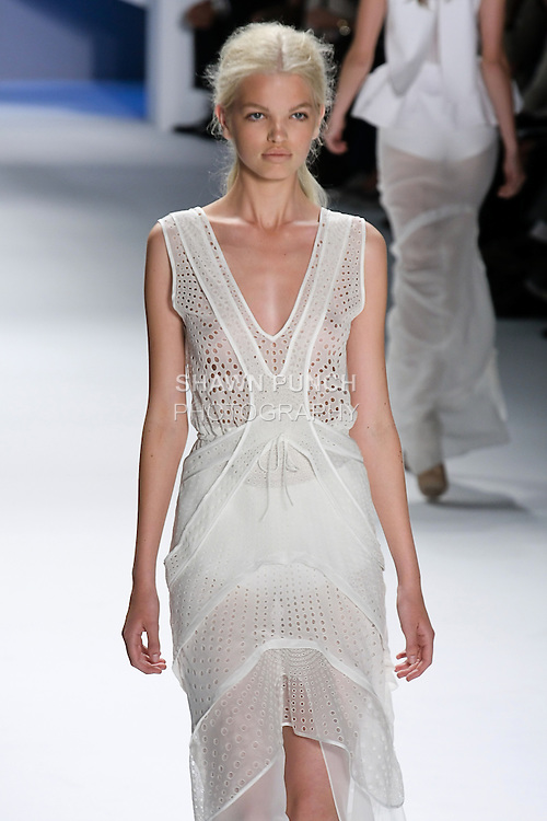 Daphne Groeneveld walks runway in a White silk chiffon eyelet tiered high-low v-neck gown, by Vera Wang, for the Vera Wang Spring 2012 collection, during Mercedes-Benz Fashion Week Spring 2012.