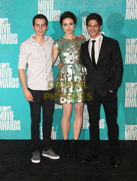 Dylan O'Brien, Crystal Reed & Tyler Posey.2012 MTV Movie Awards held at the Gibson Amphitheatre, Universal City, California, USA..3rd June 2012.full length white grey gray shirt gold green print suit jeans denim.CAP/ADM/SLP/LS.©Lee Sherman/Starlitepics/AdMedia/CapitalPictures.