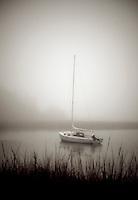 Sailboat anchored in a quiet harbor, Cape Cod, MA, USA
