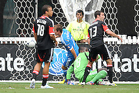 Philadelphia Union midfielder Brian Carroll (7) scores against D.C. United goalkeeper Bill Hamid (28) in the 8th minute of the game. D.C. United tied The Philadelphia Union 1-1 at RFK Stadium, Saturday August 19, 2012.