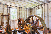 Vintage flour milling equipment inside Thompson's Mills State Heritage Site, Oregon State Parks.  Vintage, preserved, agricultureal milling equipment and site.